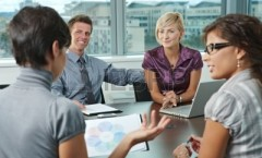 5806489-group-of-young-business-people-talking-on-business-meeting-at-office