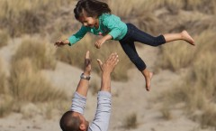 love_and_trust__father_tosses_his_confident_daughter_into_to_air_accompanied_by_screams_of_delight